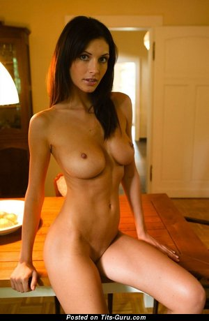 Sexy nude brunette with medium tits photo