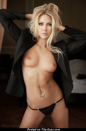 Image. Nude blonde with medium breast photo