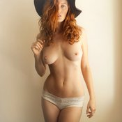 Topless red hair with medium natural boobs image