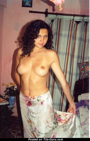 Image. Topless amateur brunette with medium natural tittes picture