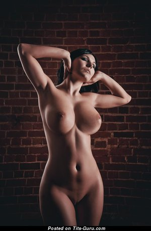 Image. Naked brunette with big breast photo