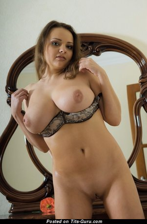 Image. Naked blonde with huge natural boobies and big nipples image