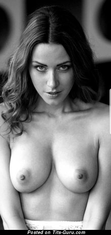 Sexy topless brunette with medium natural tittes and big nipples photo
