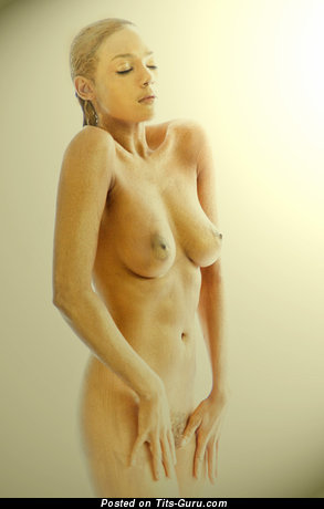 Sexy naked amazing female with medium natural tits and big nipples picture