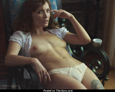 Image. Sexy hot female with natural tittes and tattoo pic