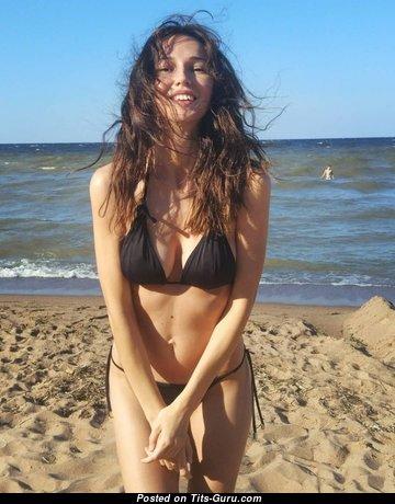 Anastasia Martzipanova - Awesome Non-Nude Russian Brunette Babe with Sexy Legs in Bikini on the Beach (Porn Picture)