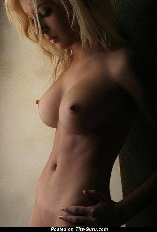 Image. Blonde with medium fake tits image