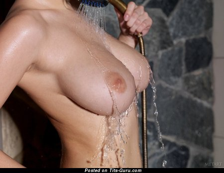 Wet topless awesome girl with medium natural boobs pic