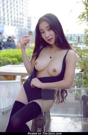 Topless amateur asian brunette with medium natural boobs picture
