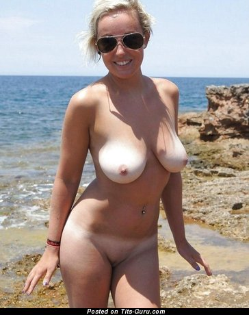 Image. Topless amateur blonde with natural tittys photo