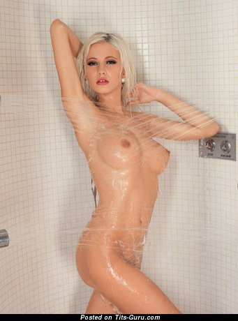 Wet naked blonde with medium boob pic