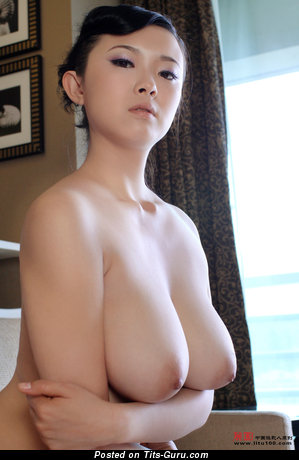 Bing Yi: naked asian with medium natural tots & big nipples photo