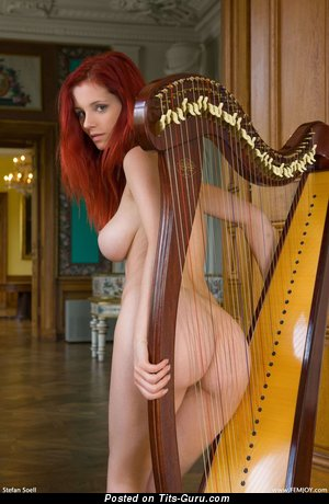 Aria Giovanni - nude red hair with medium natural tits picture