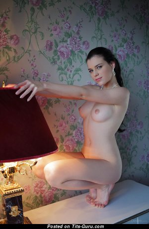 Nude nice woman with medium natural tittys photo