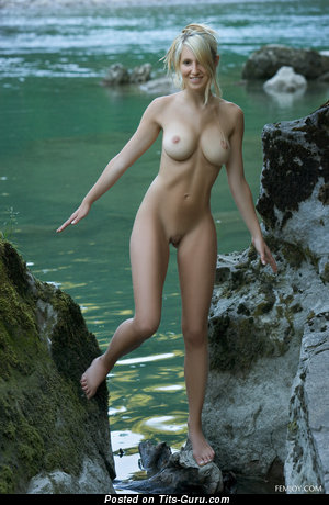 Daniela Rosch - sexy topless blonde with medium tits image