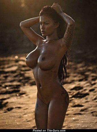 Serliana Rosida - sexy wet nude ebony brunette with medium fake boob picture