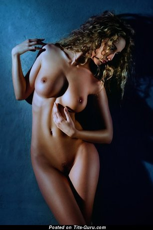Image. Nude beautiful woman with medium natural tittys photo