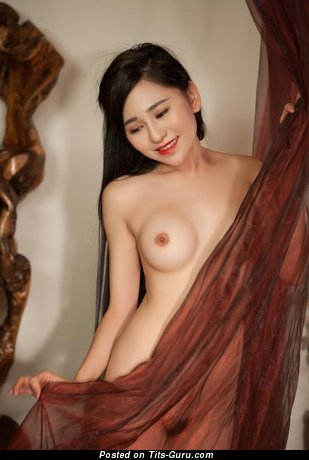 Image. Asian with medium natural tittes image