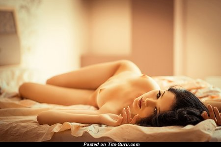 Image. Nude brunette with medium natural breast image