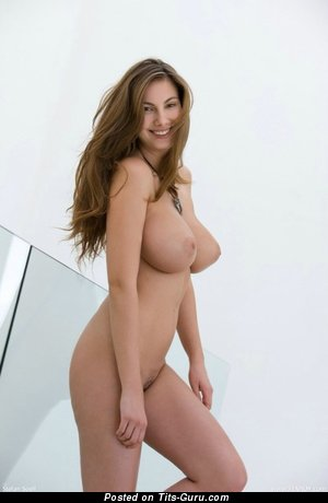 Sexy topless brunette with medium natural breast photo