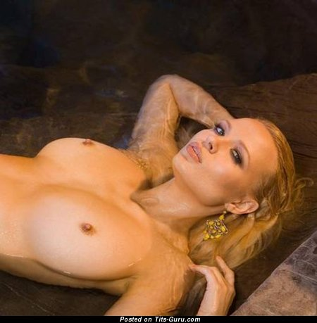Wet topless blonde with medium natural boobs photo