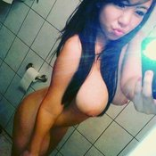Topless amateur asian brunette with big boob selfie