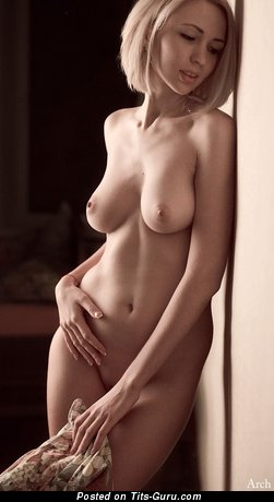 Image. Naked blonde with medium natural tits pic