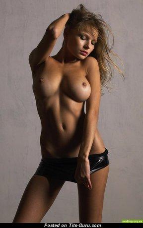 Nude amazing female with medium tots image