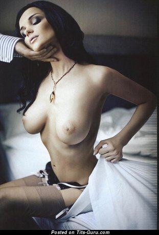 Image. Topless brunette with big natural boobies photo