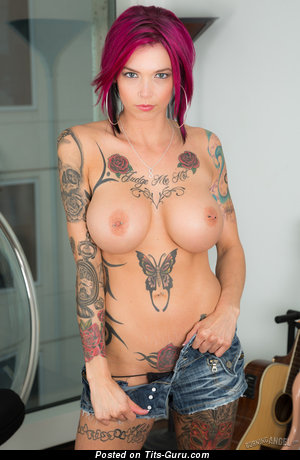 Image. Anna Bell Peaks - naked red hair with big fake tots, piercing and tattoo photo