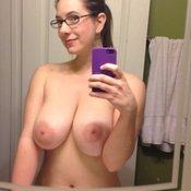 Nice woman with huge natural boobs and big nipples selfie