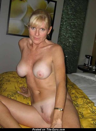 Image. Amateur nude blonde with medium natural tits picture