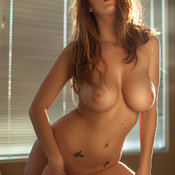Leanna Decker - naked red hair with medium tittys pic