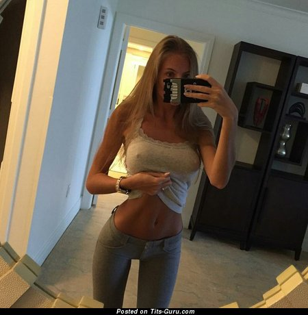 Image. Sexy amateur blonde with big tots selfie