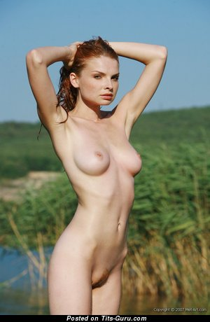 Image. Natalia - nude red hair with medium natural tittes image