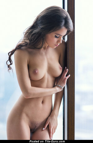 Image. Naked beautiful female with medium natural tittys pic