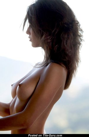 Image. Nude beautiful lady with medium natural tittys photo
