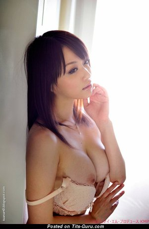 Topless asian with natural boob pic
