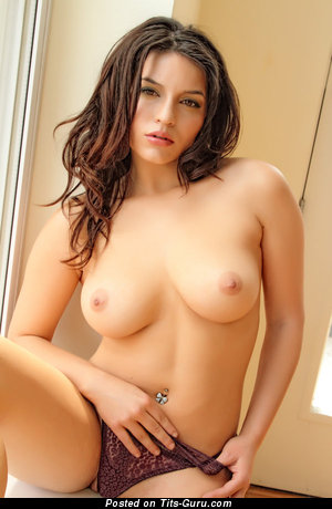 Sexy topless brunette with big natural tits pic