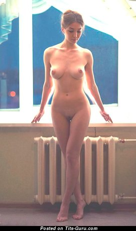 Image. Nude nice female with medium natural tittes photo