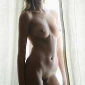 Sexy topless amateur beautiful female with medium natural tits photo