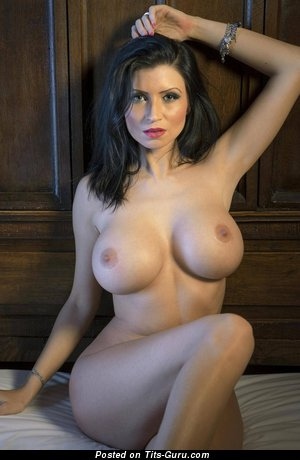 Lilly Roma - sexy nude brunette with medium fake boobs picture