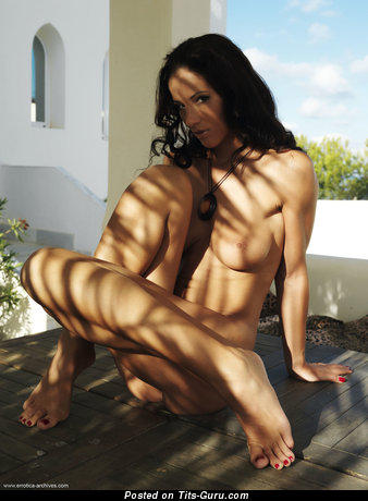 Image. Angel Dark - naked brunette with medium natural boobies photo