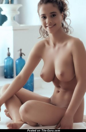 Nude brunette with medium natural boobs photo