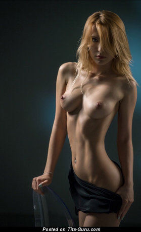 Image. Sexy naked blonde with medium natural tittys pic