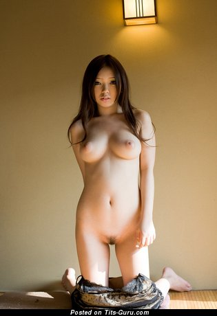 Image. Sexy nude asian brunette with big natural tittes image