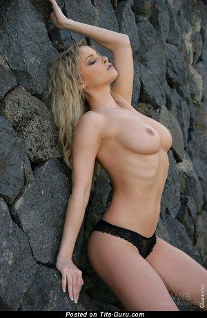 Nude beautiful woman with medium natural breast photo