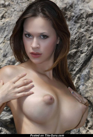 Image. Naked brunette with medium boobs photo