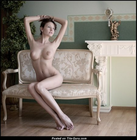 Image. Nude brunette with medium natural boob photo