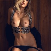 Sexy topless blonde with medium tittys image
